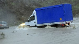 Truck attempts to manoeuvre down a flooded street around Torpe near Nuoro on Sardinia island