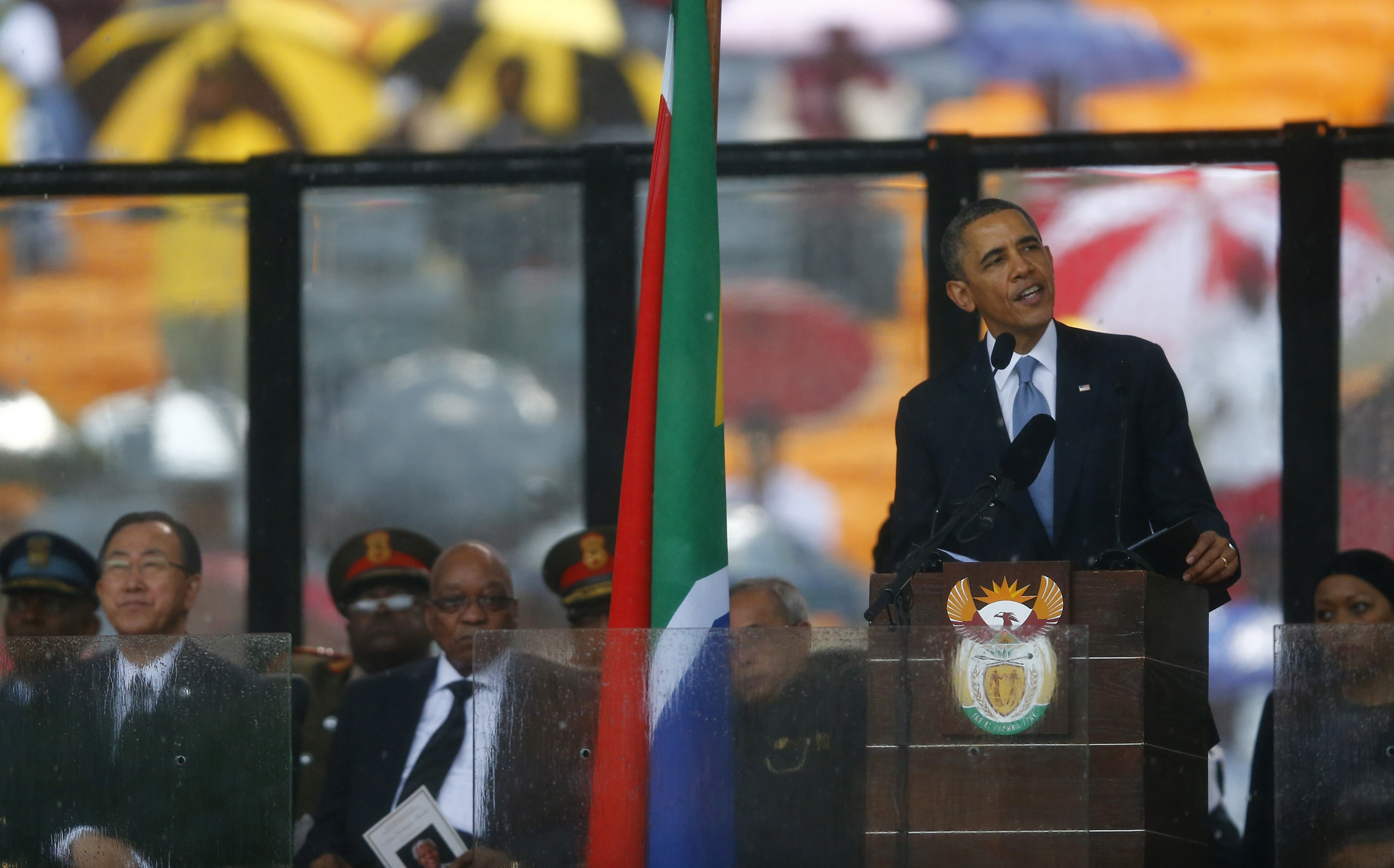 U.S. President Barack Obama delivers his speech at the memorial service for late South African President Nelson Mandela at the FNB soccer stadium in Johannesburg