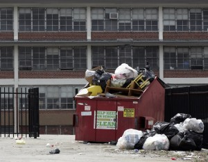 Trash overflows from a container in the parking lot of the Anna B. Pratt Elementary School, in North Philadelphia, shut down after the 2012-2013 school year.