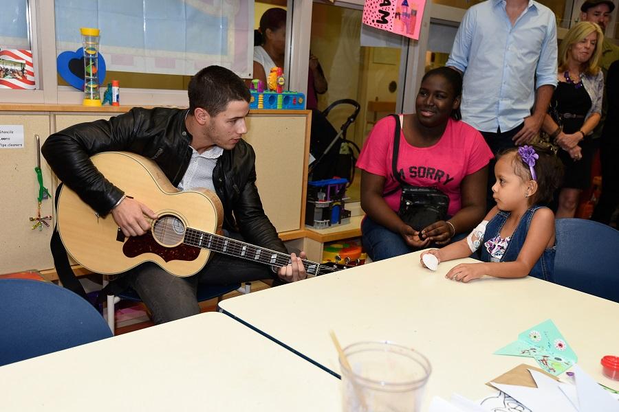 CHAM Nick Jonas with kids 09-14
