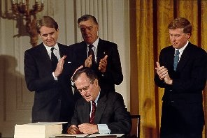President Bush in 1990 signing  act amending Clean Air Act