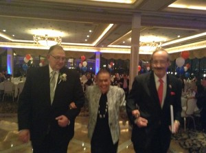 Congressman Eliot Engel and Al D'Angelo escorting Blanch Rifkin to the podium