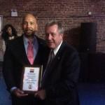 Borough President Ruben Diaz Jr. presenting John. F. Wade award to Councilman Danny Dromm