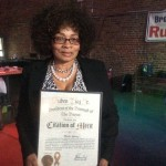Marie Spivey wuth award she received from BP Diaz