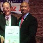 Dr. Douglas Reich receiving his award from BP Diaz