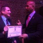 Damon Jacobs receiving 2015 Rainbow Ribbon Award from BP Diaz
