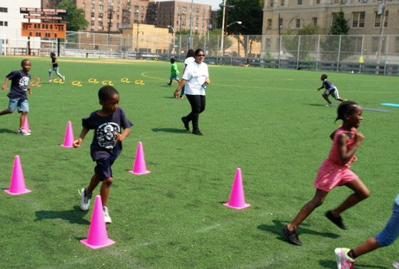 Children run the obstacle course during BCHN's Health Fair Field Day.