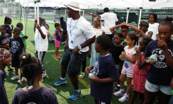 BCHN's Alexei Silva teaches the children the steps for the Nae Nae.