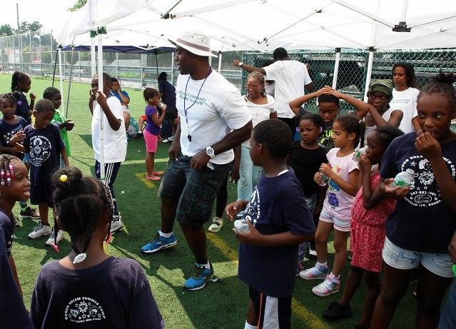 BCHN's Alexei Silva teaches the children the steps for the Nae Nae.