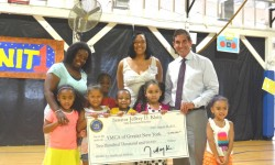 Senator Jeff Klein, Executive Director of The Bronx YMCA Sharlene Brown, and YMCA campers.
