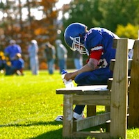 athlete-football_on_bench_Get Your Head In The Game