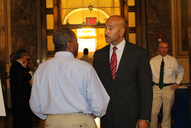 Bronx Borough President Ruben Diaz Jr. speaks with a job seeker during a job fair in the Bronx County Building on Tuesday, September 22, 2015. The event, which was co-sponsored by the borough president, the New York State Department of Labor and the Bronx Overall Economic Development Corporation, featured representatives of 23 companies offering 1,000 jobs, and was attended by hundreds of individuals.