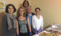 Moujan Vahdat and his family hosting community dinner at Pelham Grand