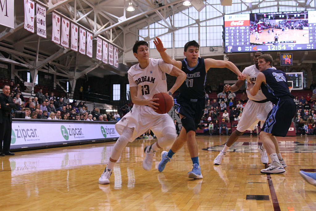 Junior guard Matt Massimino takes the rock into the paint for two of Fordham's 70 points.