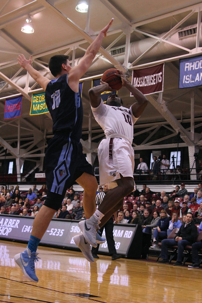 Fordham's Jon Severe (10) seems suspended in the air as pump fakes his way to two point jumper.