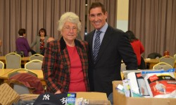 (L-R): Aunt Cathy Praino and State Senator Jeff Klein prepare holiday packages for the troops.