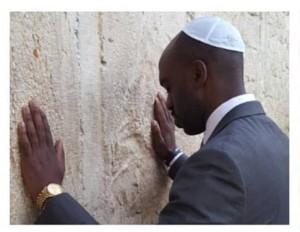 Assemblyman Michael Blake praying at the Western Wall