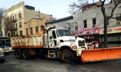 A NYC Sanitation plow seen on East 187th street in the Bronx. Photo courtesy of Gonzalo Duran.