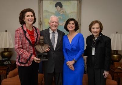 L-R: Lynda Johnson Robb, President Jimmy Carter, Luci Baines Johnson, Rosalynn Carter. Photo by Michael A. Schwarz