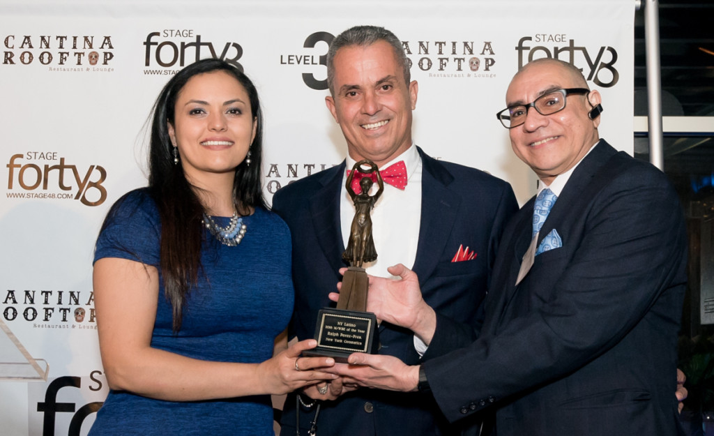 The M/WBE Award Recipient Ralph Perez, President of NY Geomatics with his daughter Angie Ramirez as they are presented their award by Rick Miranda, President of the Brooklyn Hispanic Chamber of Commerce.
