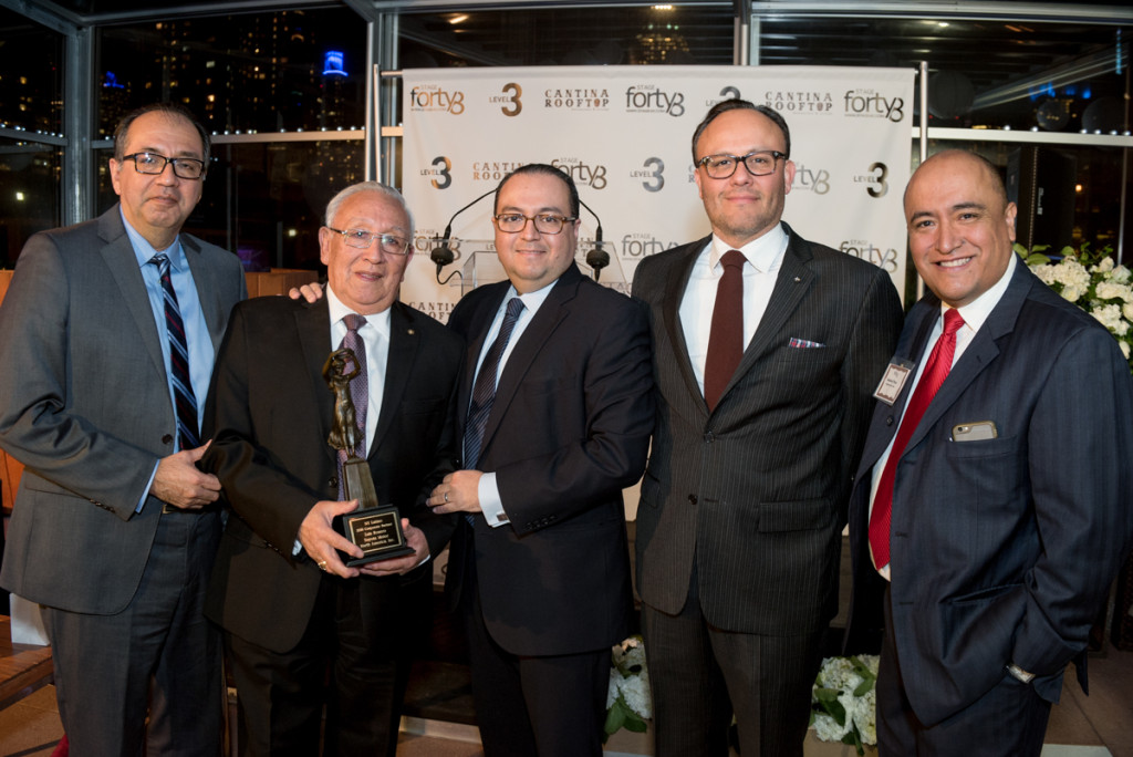 The Corporate Award recipient Luis Rosero, Director of Hispanic Strategies for Toyota Motor North America, Inc.(Third from Left) shares the moment with his father who is shown holding the award.