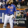 New York Mets shortstop Ruben Tejada, whose leg was broken in a hard slide by Los Angeles Dodgers second baseman Chase Utley in Game 2, tips his cap during baseline introductions for baseball's Game 3 of the National League Division Series, Monday, Oct. 12, 2015, in New York. (AP Photo/Kathy Willens)