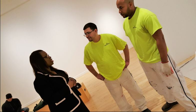 CM Vanessa L. Gibson chats with DC 9 apprentice painters Christian Ildifonso and Jorge Arias.