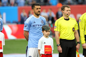 Team captian David Villa stands with a youth soccer payer during the pre-game ceremonies. Credit: Gary Quintal