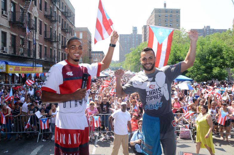 Felix Verdejo and Christopher Diaz greet a friendly Bronx Puerto Rican crowd on 151st street in the South Bronx. Photo by Peter Amador for Top Rank Boxing.