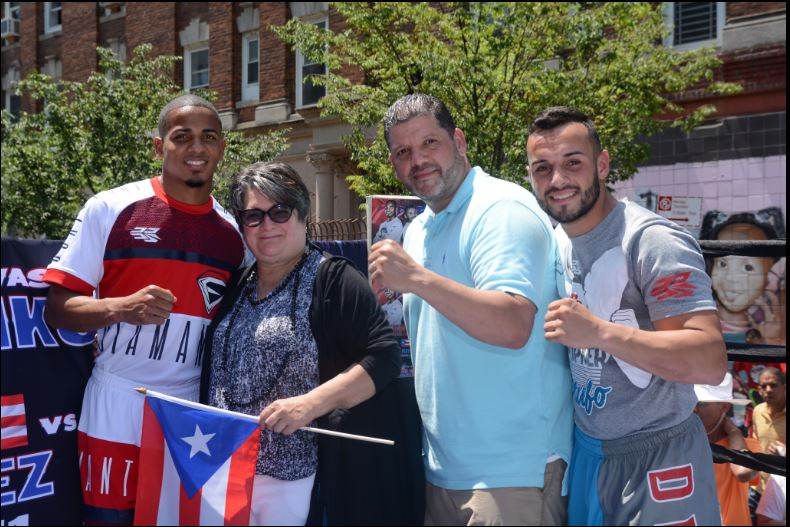 Felix Verdejo and Christopher Diaz pose with Lorraine Cortes-Vazquez (center), board chairperson of the National Puerto Rican Day Parade, Inc. Photo by Peter Amador for Top Rank Boxing.