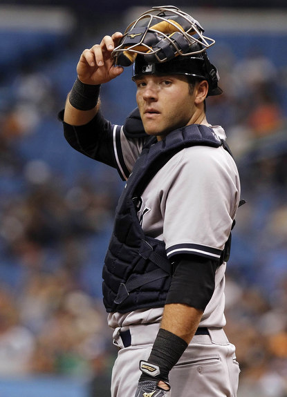 May 26, 2013; St. Petersburg, FL, USA; New York Yankees catcher Austin Romine (53) during the eighth inning against the Tampa Bay Rays at Tropicana Field. Tampa Bay Rays defeated the New York Yankees 8-3. Mandatory Credit: Kim Klement-USA TODAY Sports