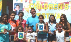 Senator Klein posing with local youth at the Children's Festival.