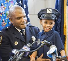 Captain Keith Walton, 49th Precinct NYPD and Tyrone Lowe. Credit: NY Daily News