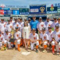 "Bronx Borough President Ruben Diaz Jr. and Marissa Shorenstein, New York State president, AT&T, present the championship trophy for the sixth annual ""Borough President's Cup"" Little League Championship to Grand Slam Little League."
