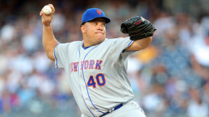 Aug 4, 2016; Bronx, NY, USA; New York Mets starting pitcher Bartolo Colon (40) pitches against the New York Yankees during the first inning at Yankee Stadium. Mandatory Credit: Brad Penner-USA TODAY Sports