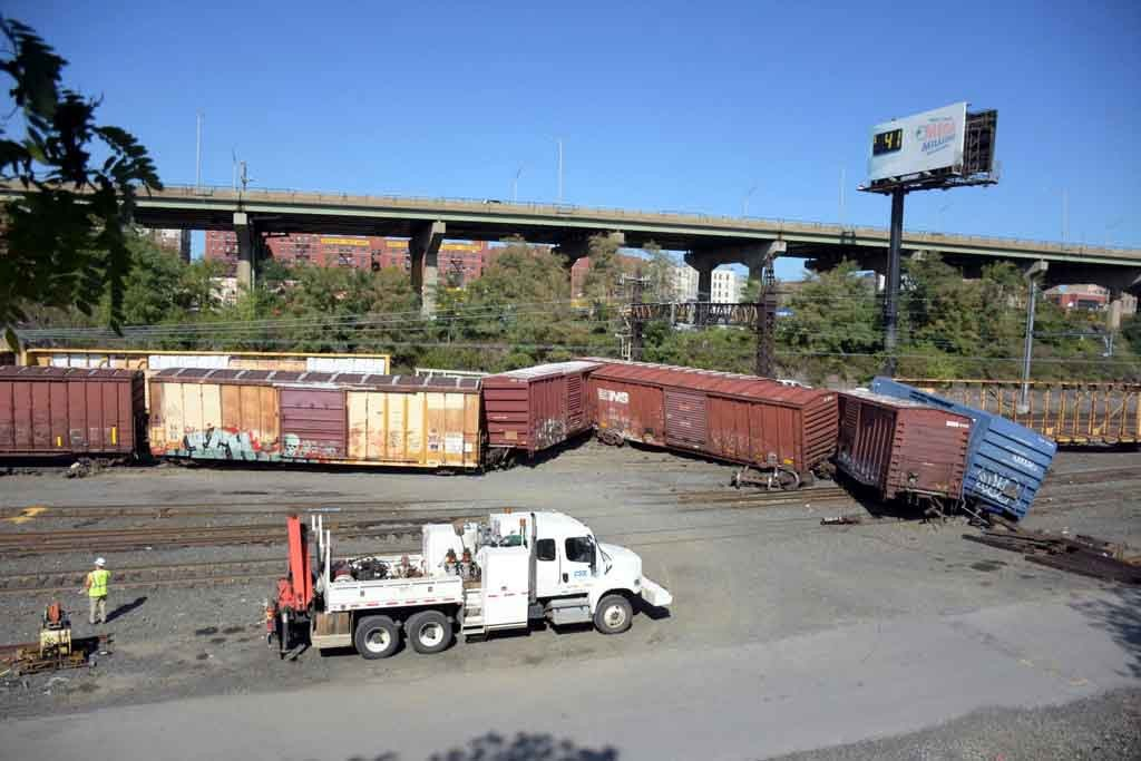Rail cars got knocked at the Oak Point Rail Yard as the crash stranded thousands of commuters.--Photo by Edwin Soto