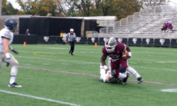 Chase Edmonds fights for yardage as the Rams battle against Georgetown on Saturday. (Andrea Garcia/The Fordham Ram)