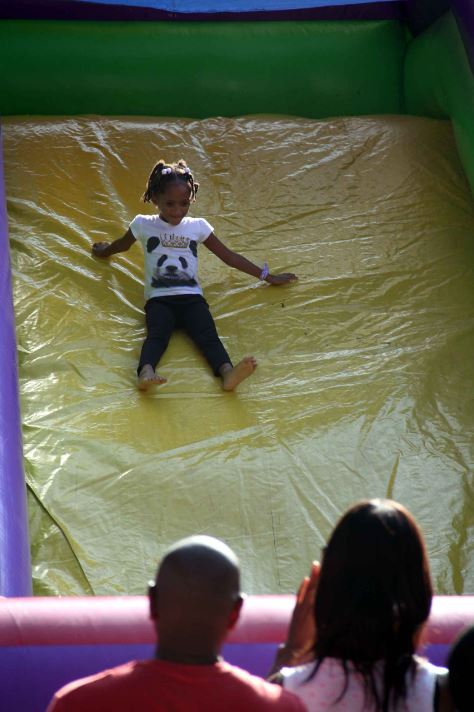 A youngster enjoys a good slide along Jerome Avenue.--Photo by David Greene