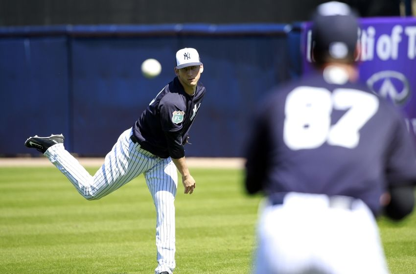 New York Yankees pitcher James Kaprielian (90) and pitcher Brady Lail (87) work out at George M. Steinbrenner Field. Photo Credit: Kim Klement, USA TODAY Sports
