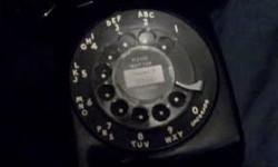 A mid-twentieth century rotary-dial telephone