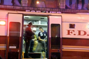 An unidentified firefighter is treated by paramedics for smoke inhalation.--Photo by Edwin Soto
