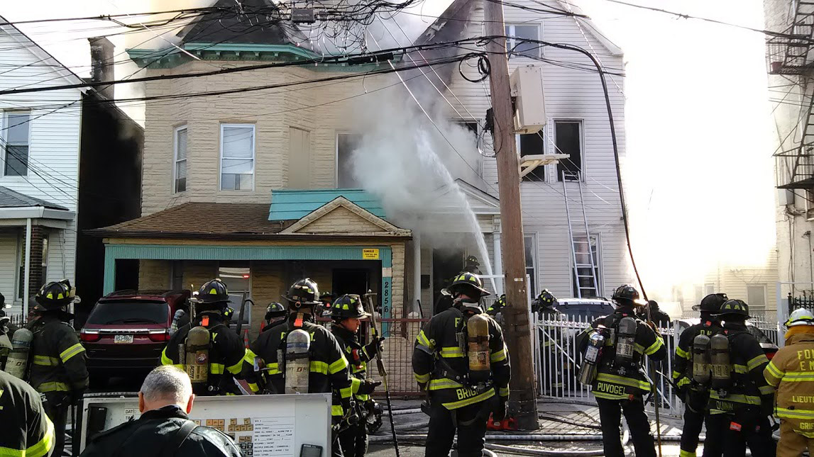 More than 150 firefighters battled the blaze along Briggs Avenue in Bedford Park. Photo by Jimmy Velez
