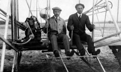 Orville and Wilbur Wright aboard their Wright Flyer.