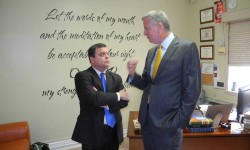 Mayor Bill di Blasio (left) is greeted by Assemblyman Luis Sepulveda at the Parkchester Baptist Church. Photo by Bob Kappstatter
