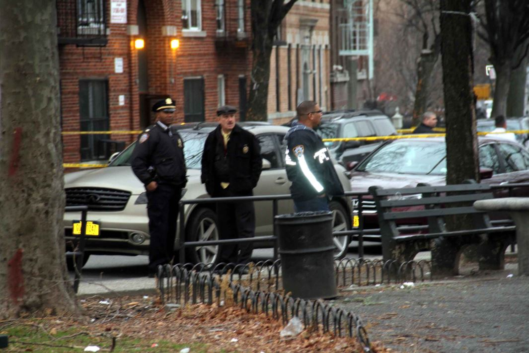 Police investigate a large crime scene as shooting broke out across the street from a popular park. Photo by David Greene