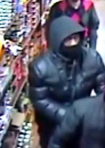 A surveillance photo shows a second gunman who entered the store. Photo courtesy of the NYPD