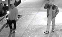 Another surveillance photo shows the two suspects fleeing north on Bainbridge Avenue after the stick-up.  Photo courtesy of the NYPD
