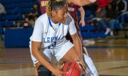 Lehman's Marika Gordon makes way to basket against Brooklyn College defender during CUNYAC conference game at APEX Gym, in the Bronx New York on Friday January 20, 2017. (Photo credit: Robert Cole)