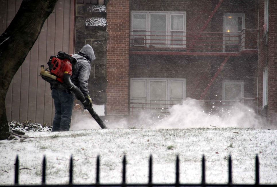 A worker uses a snowblower outside of the St. James Episcopal Church on Jerome Avenue in Kingsbridge. Photo by David Greene