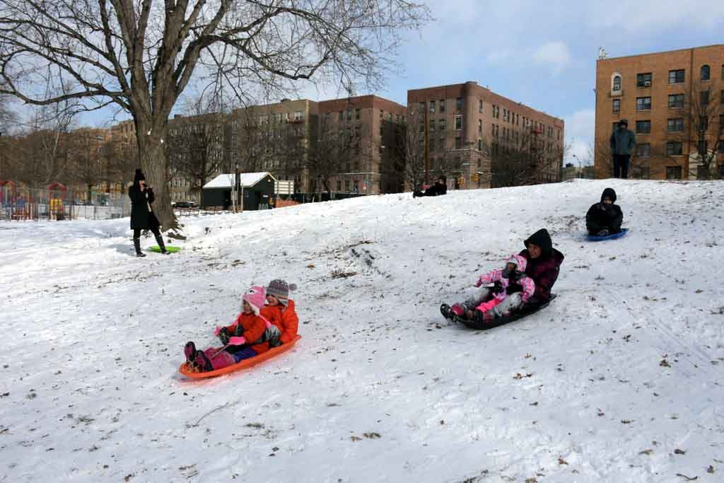 4 Yrs. old twins Angelena and Leonardo Olivera and Madison (2), Katelyn (14) & Jason Pena (10) having a great time sledding in Bronx Park.